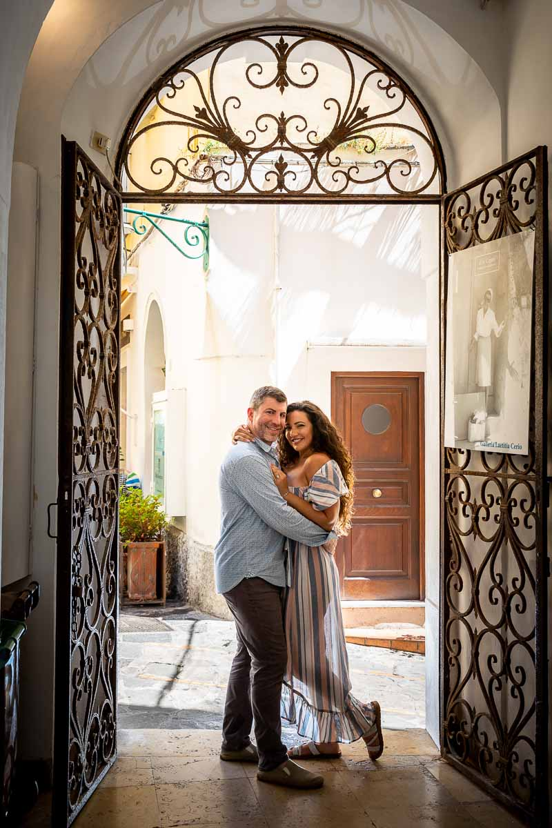 Couple portrait picture with special external lighting taken in front of a nice doorway