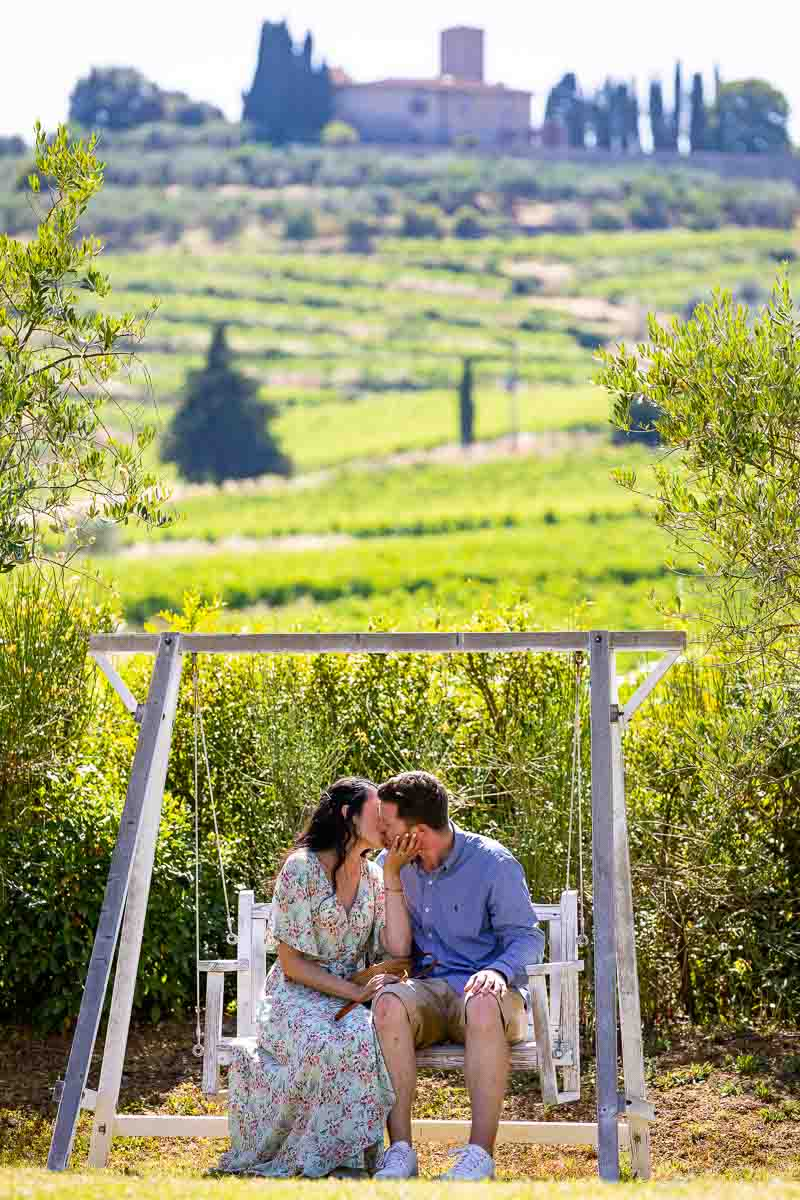 Couple kissing in Italian tuscany countryside