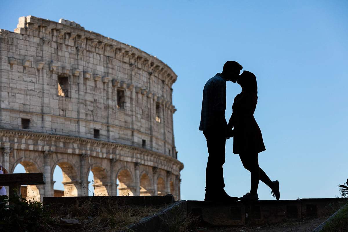 Artistic silhouette photography at the Roman Coliseum. Honeymoon Photo Shoot in Rome