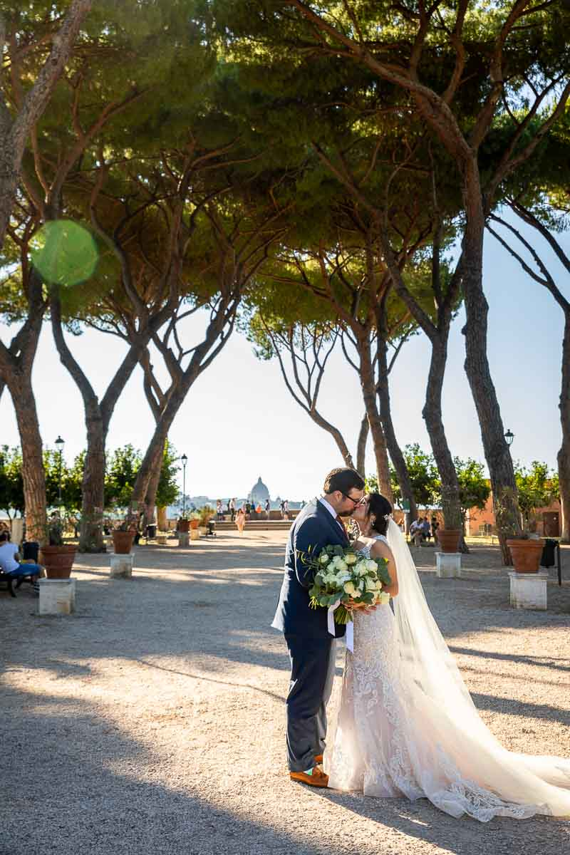 Bride and groom photographed underneath Mediterranean pine trees at Giardino degli Aranci in Rome Italy