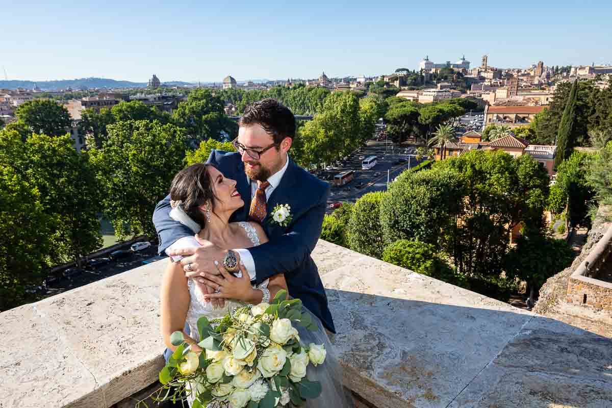 Newlyweds happy in love taking pictures with the roman city in the background