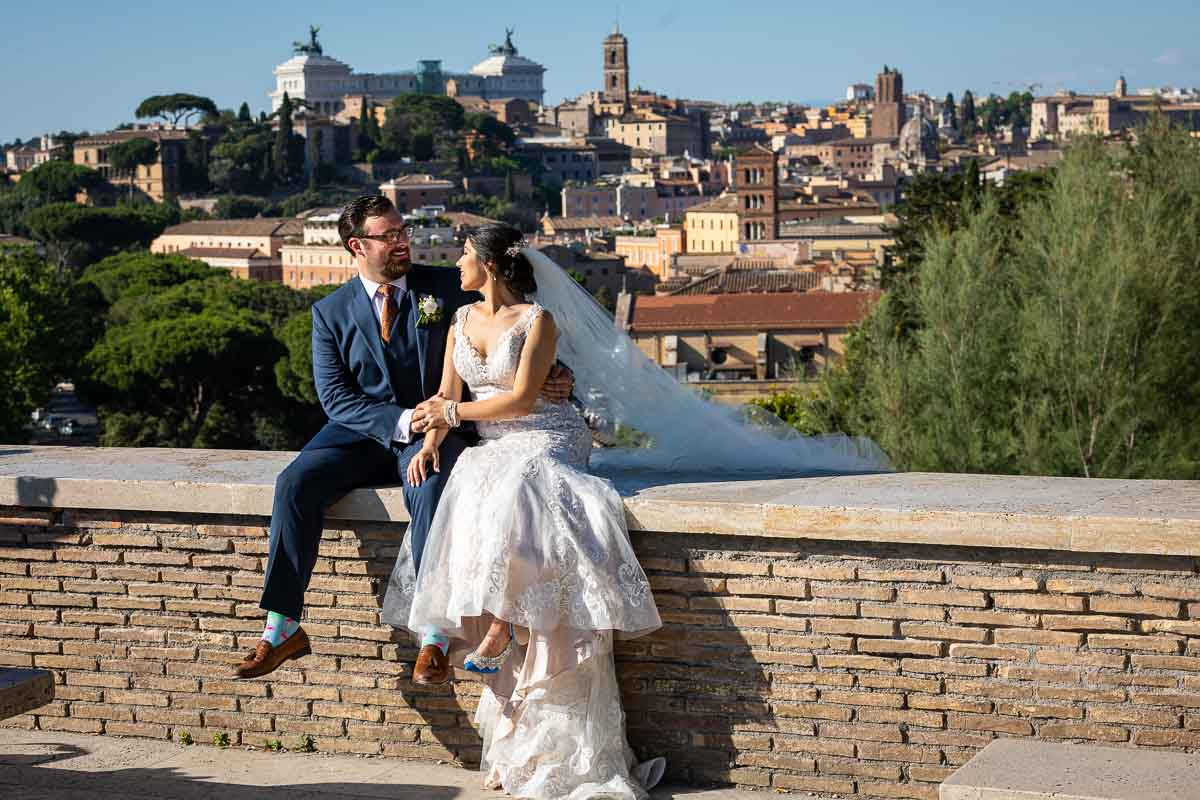 Bride and groom photographed at the Orange Garden terrace with the city of Rome as backdrop