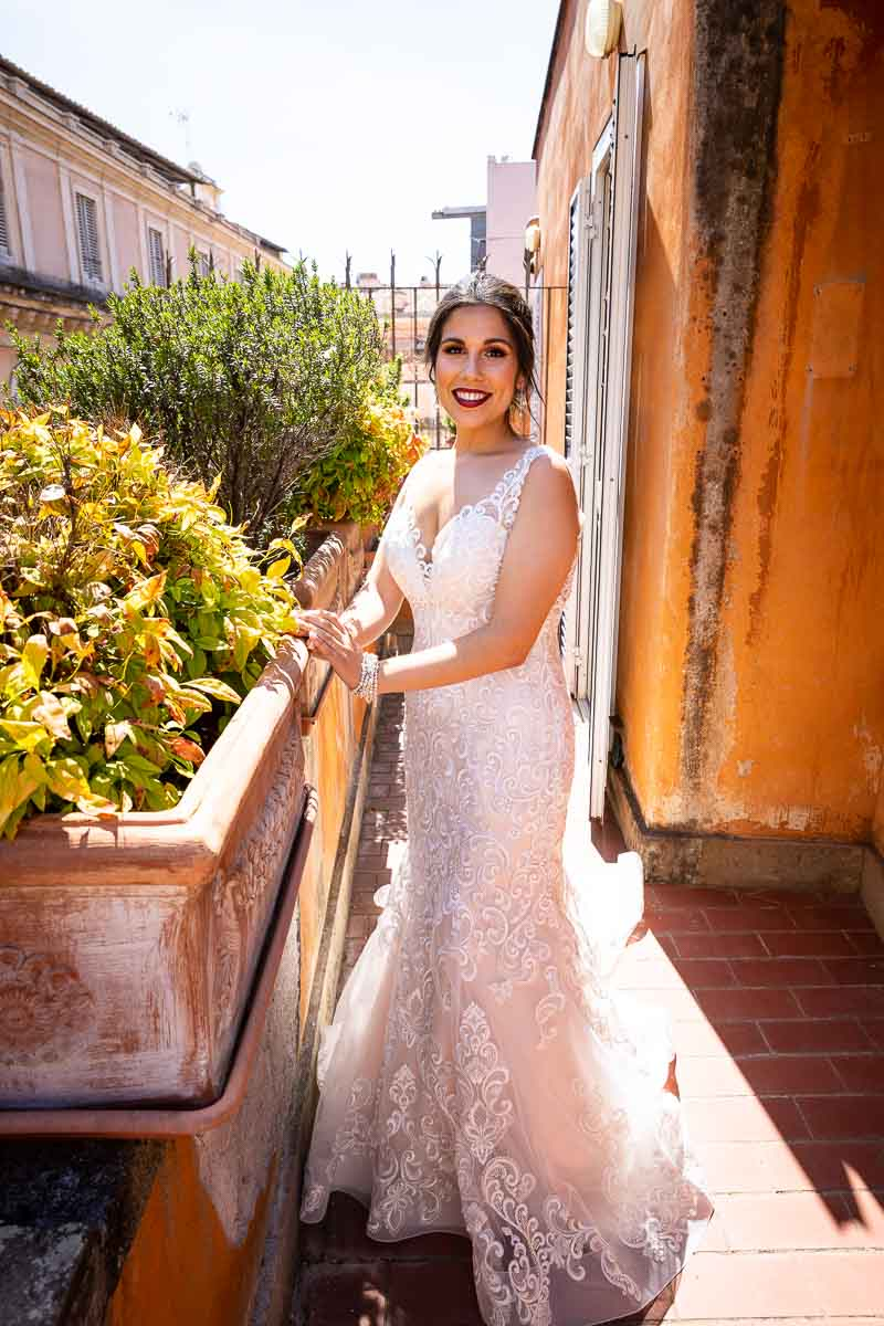 Bride full view on the hotel balcony
