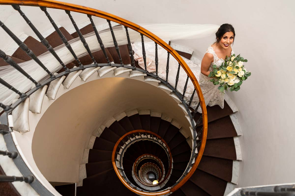 Bridal portrait taken on the spiral steps contained within the hotel