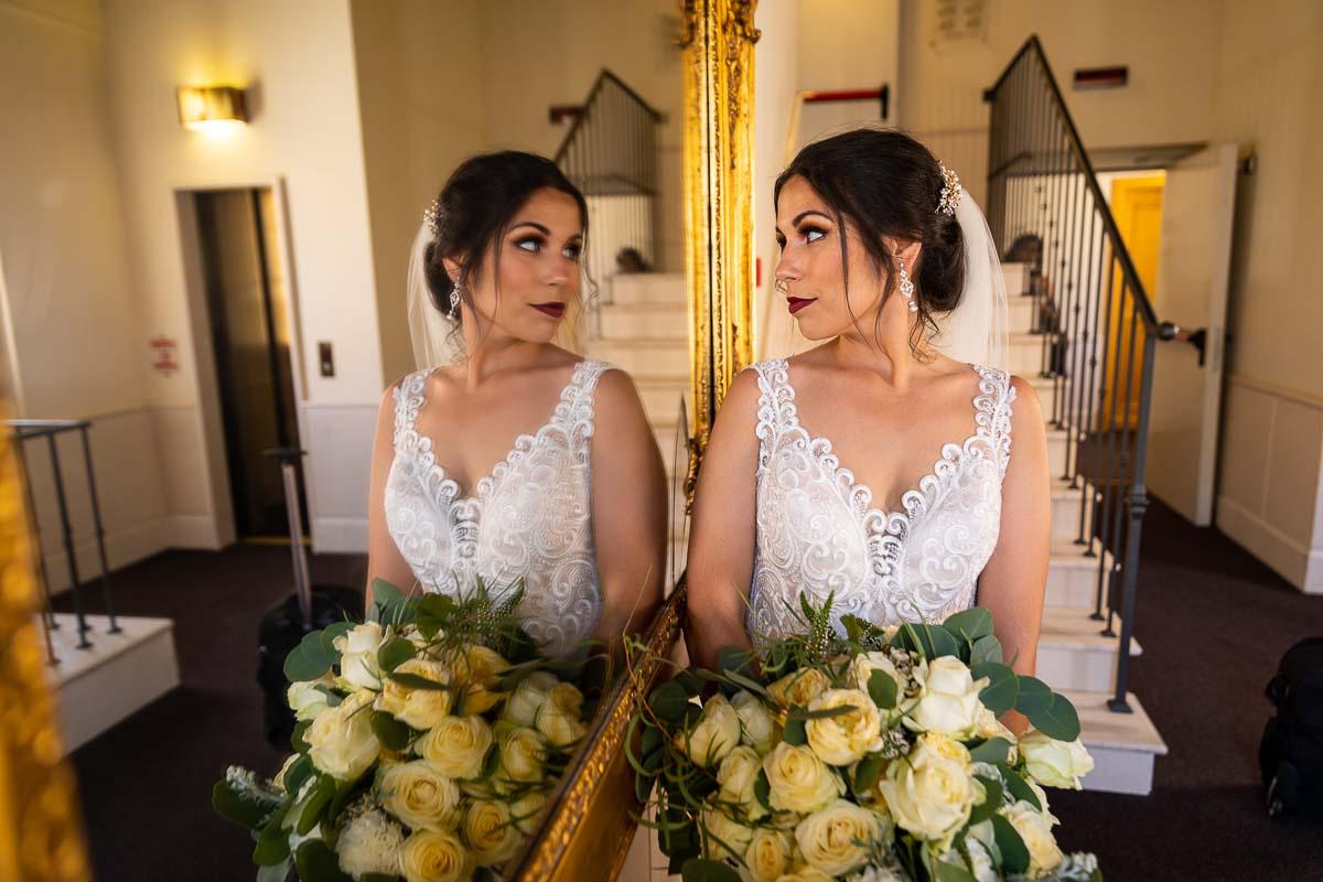 Bride looking into the mirror reflection