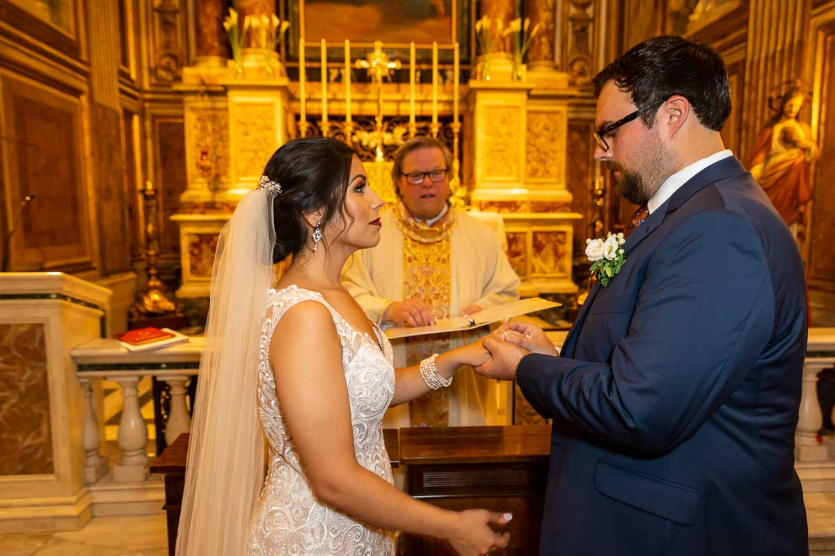 Bride and groom getting married inside roman catholic church