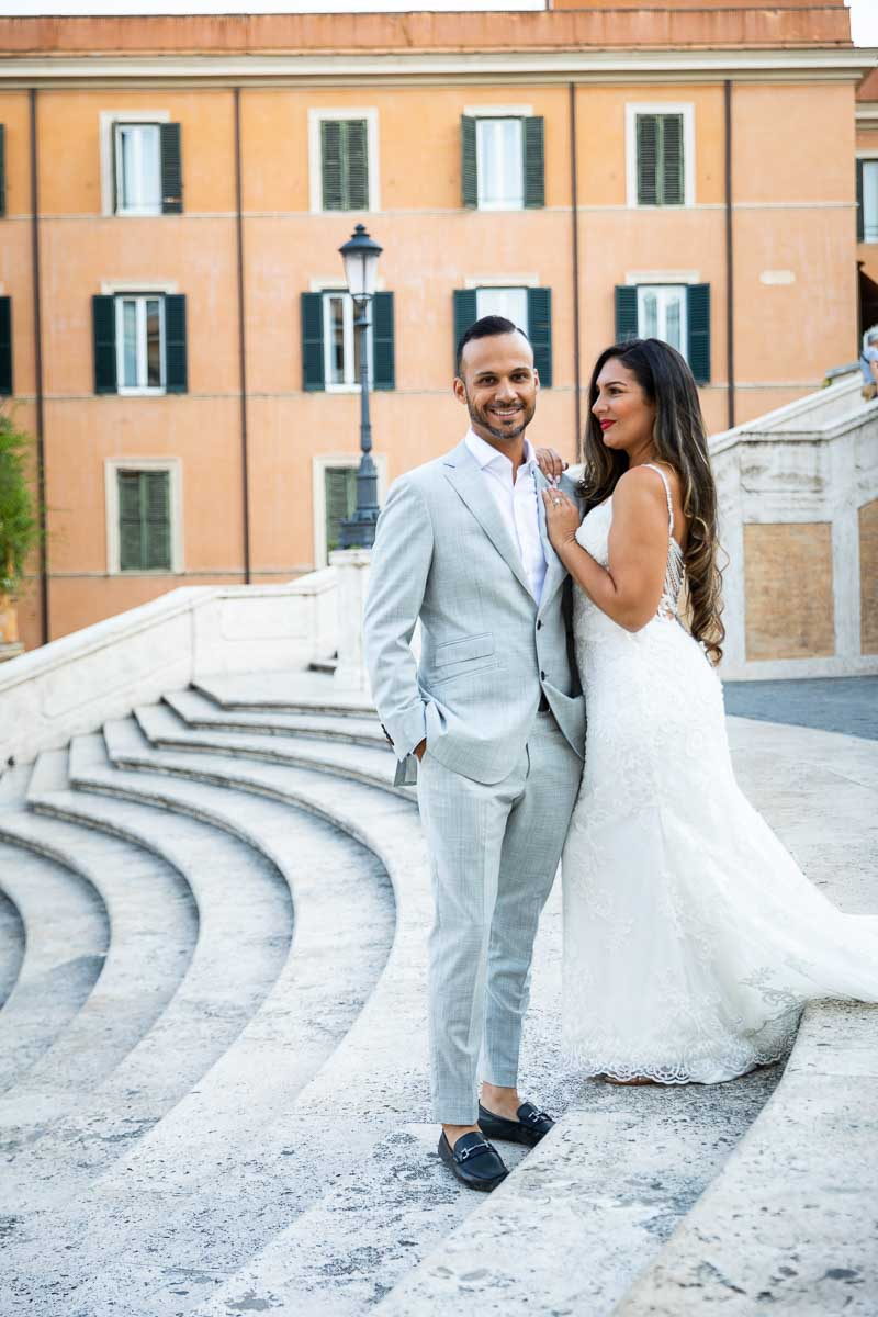 Close up portrait of the groom standing next to the bride during a photo session in Piazza di Spagna staircase