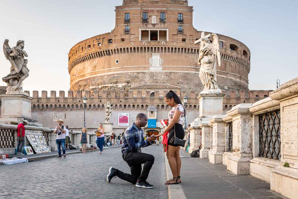 Proposing marriage on the bridge in front of the Sant'Angelo Castle in Rome Italy
