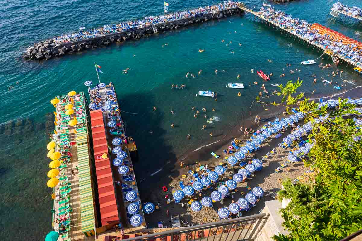 Seaside beach resort from the Sorrento coast photographed from above showing the multiple colors of the sea