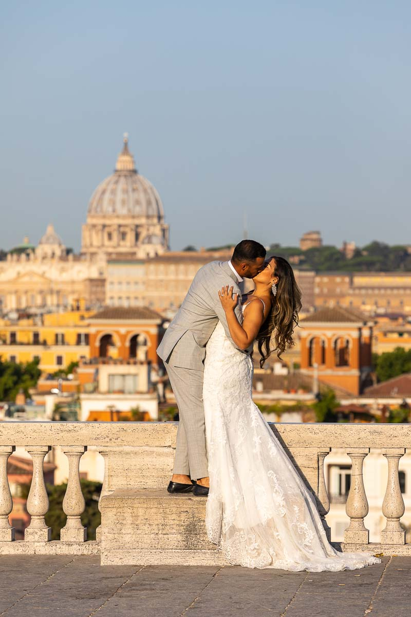 Wedding kissing picture before the roman skyline during a photohoot