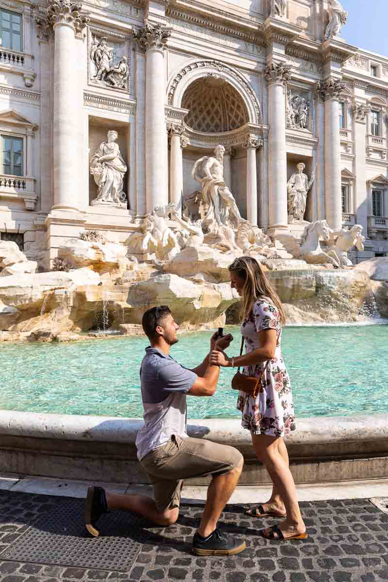 Asking the big question knee down wedding proposal at the Trevi fountain in Rome Italy
