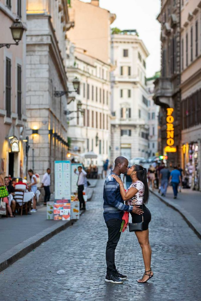 Roman cobblestone alleyway street couple photoshoot at dusk