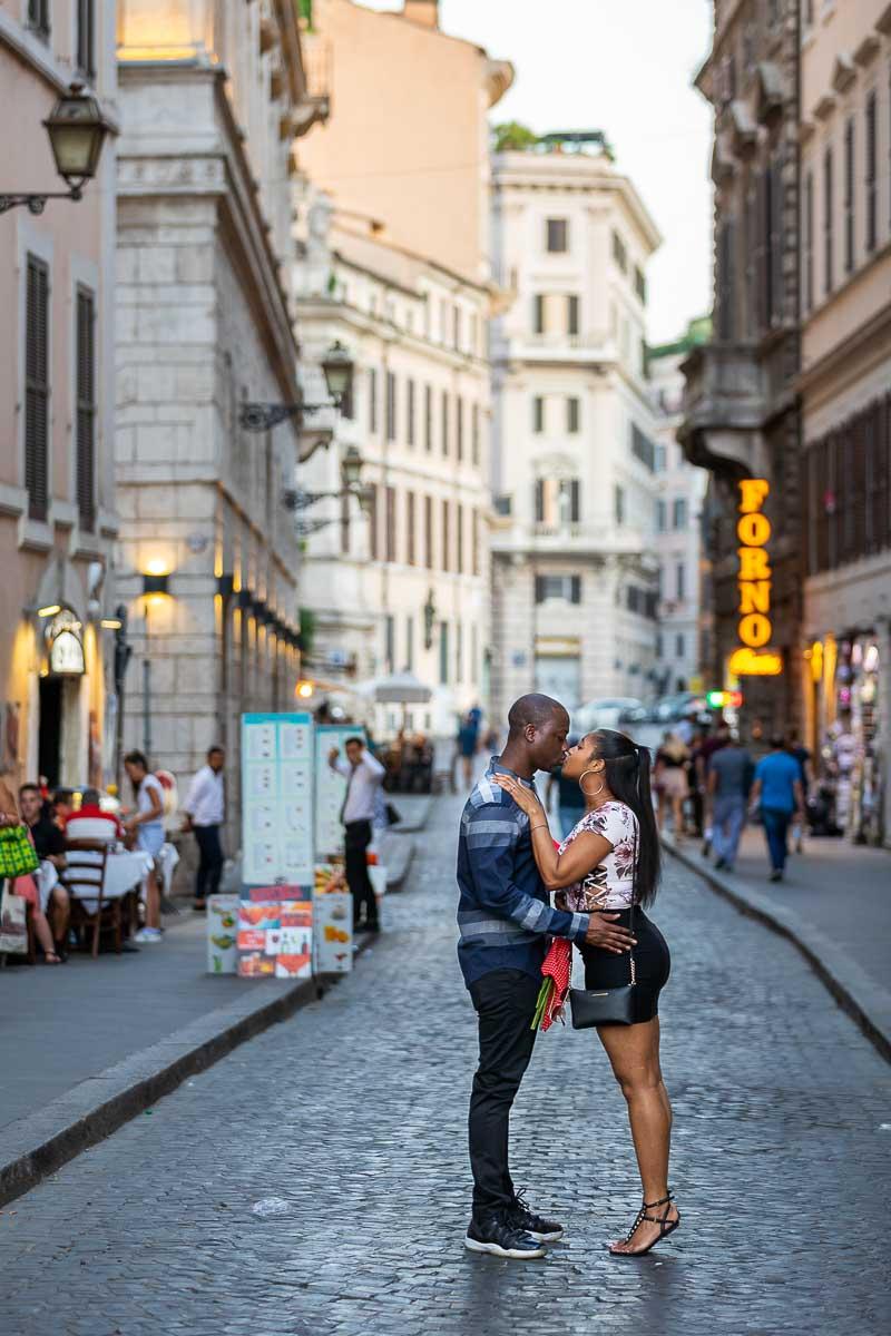 Roman cobblestone alleyway street couple photoshoot at dusk