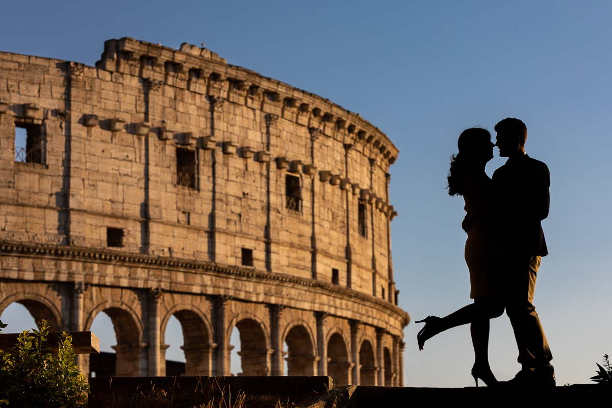 Silhouette photo of a couple posing during an engagement photo shoot in Rome at the Colosseum