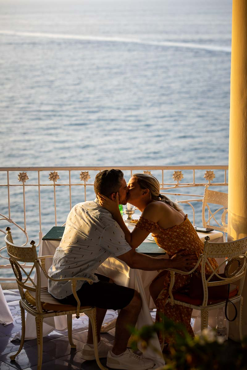 Just engaged in costiera sorrentina. Kissing by seaside view