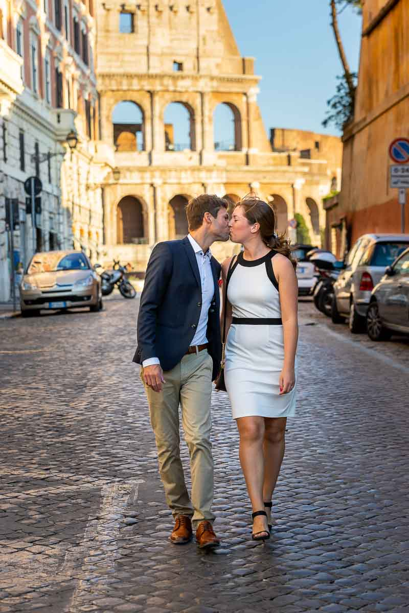 Walking in Rome while kissing on ancient cobble stone alleyway street