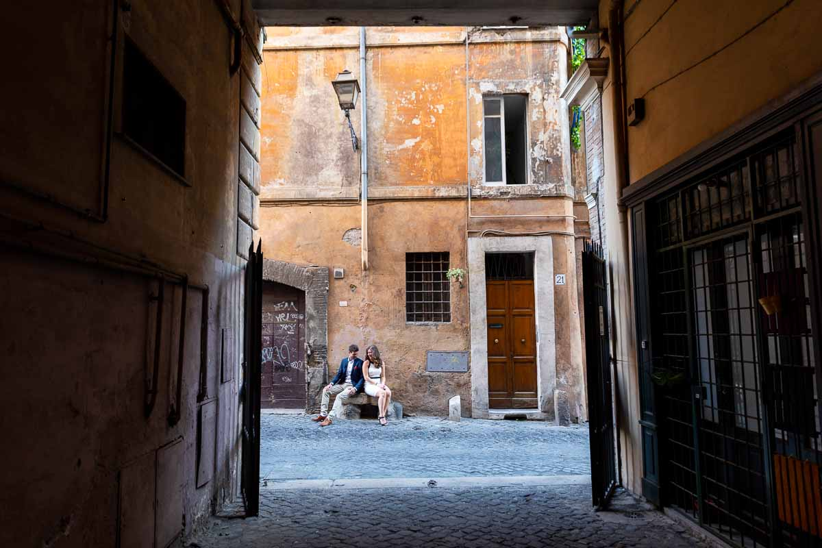 Sitting down on a roman alley posing for a picture