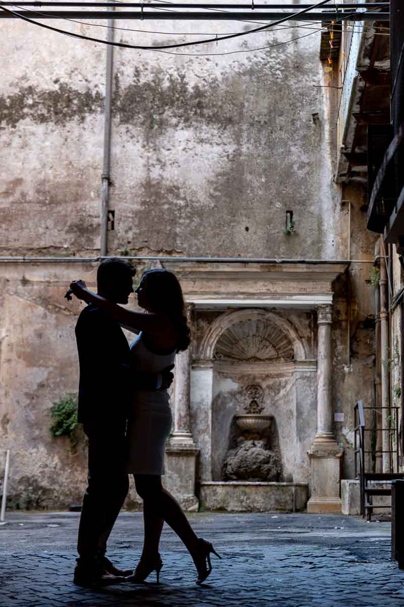Silhouette image of a couple surrounded in a roman environment