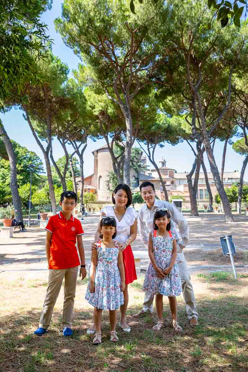 Family group photo taken inside the Orange Gardens on the Aventine Hill in Rome Italy