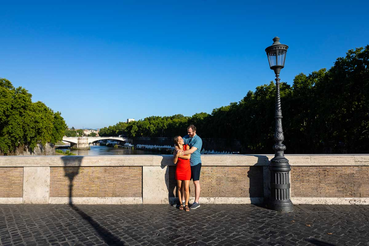 Taking pictures together during a photo shoot on Ponte Sisto bridge in Rome