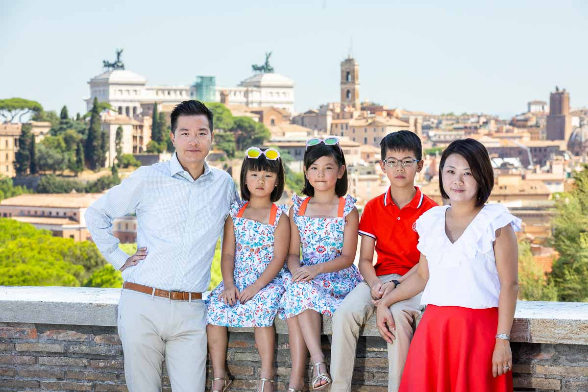 Family portrait with the ancient city view of Rome Italy in the background