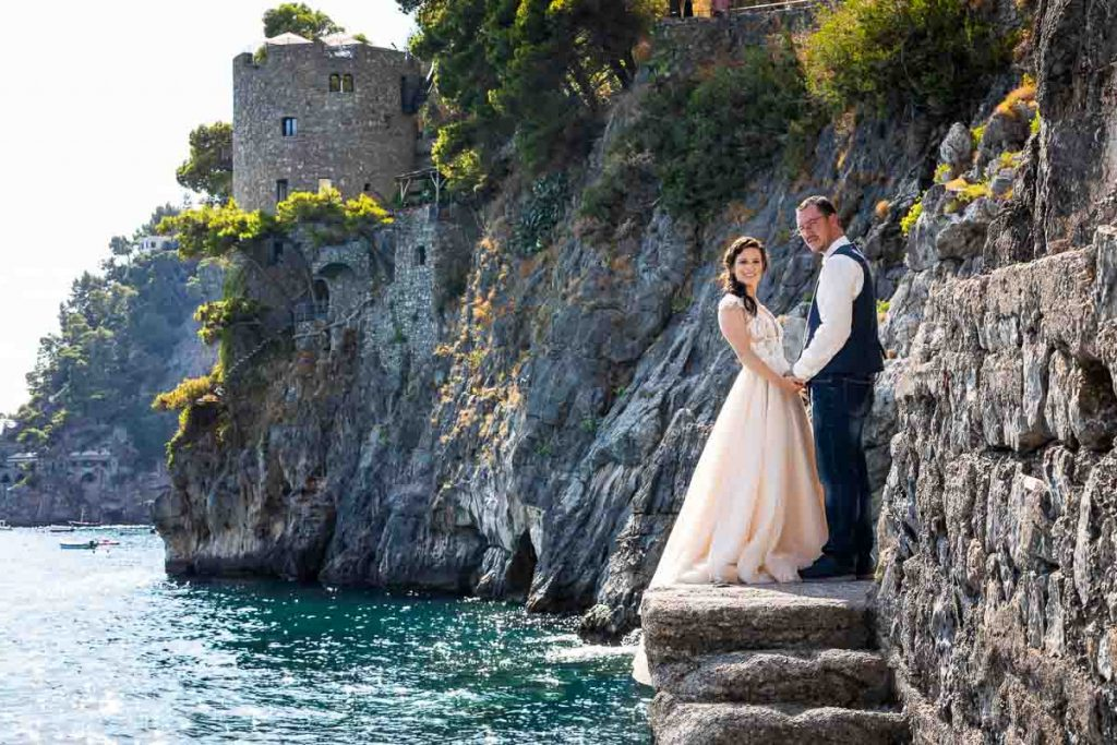Amalfi coast wedding photoshoot by the Andrea Matone photography studio. Photo taken on the Positano beach side marina