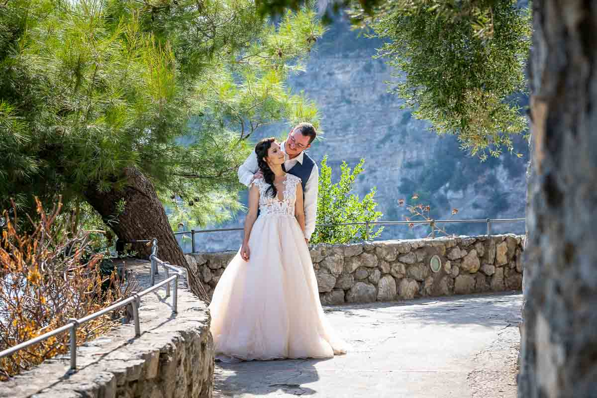 Posed image of being together during a matrimonial photo session in a Mediterranean Italian setting