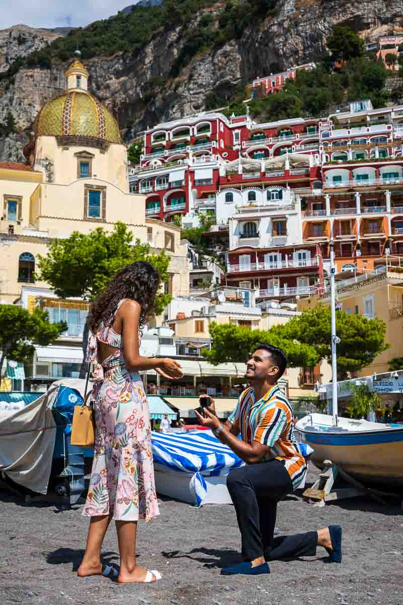 Knee down wedding marriage proposal on the beach of Positano in Italy's Amalfi coast