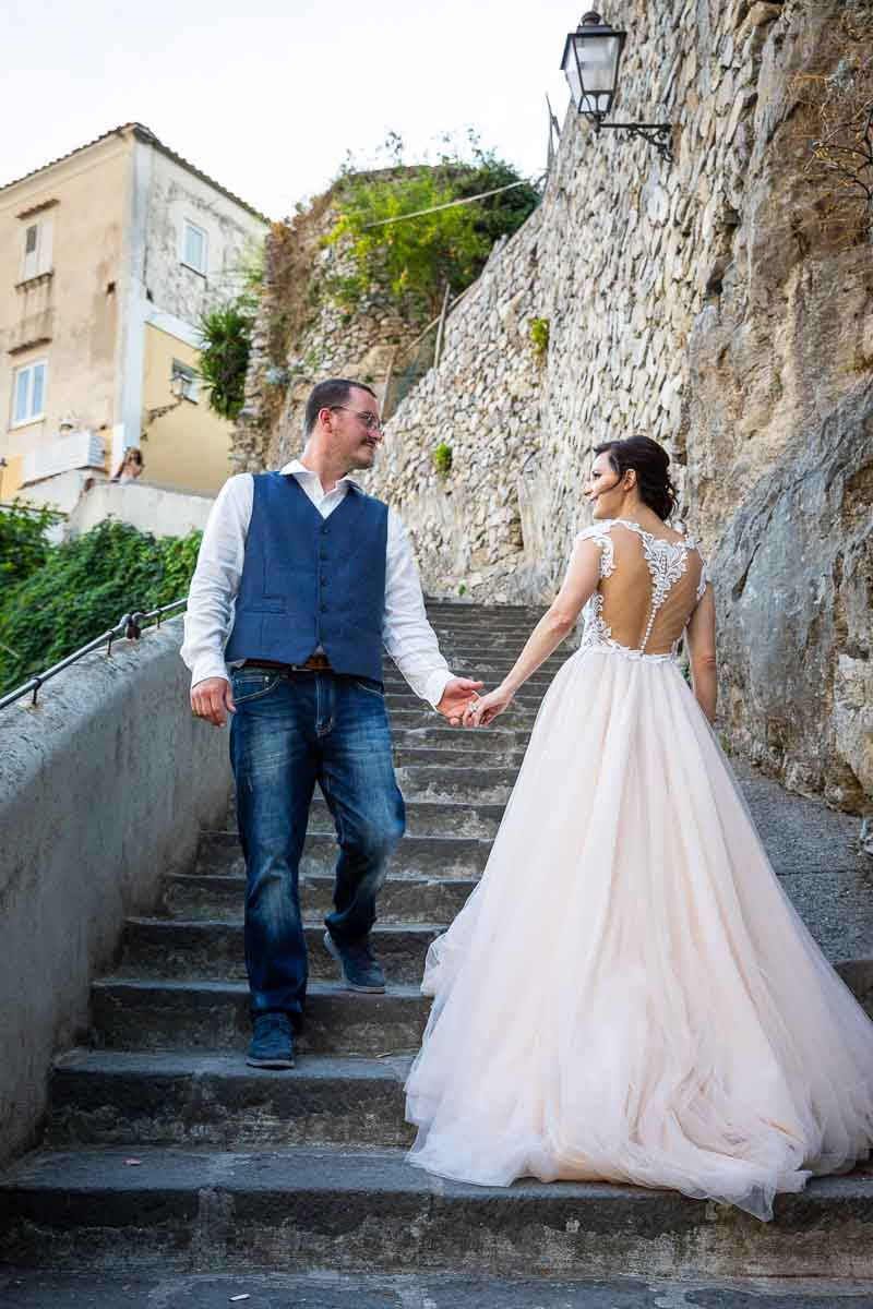 Walking up and down stairs during a wedding photoshoot in Italy