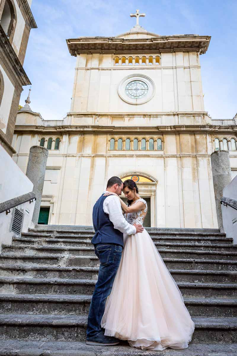 Just married couple posing on the steps of a Cathedral church Elopement Wedding in Positano