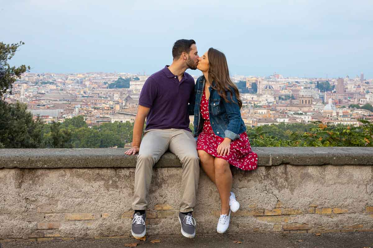 Just engaged in Rome Italy taking engagement pictures with the roman skyline in the background