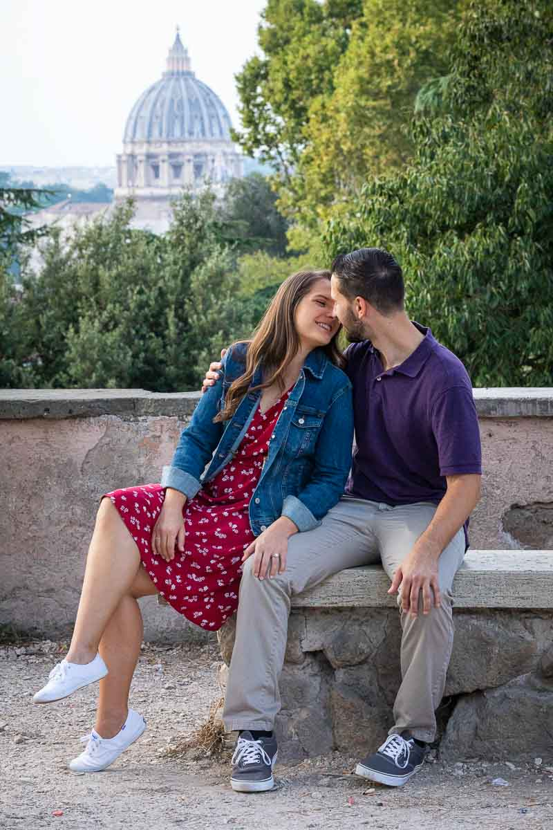 Couple photoshoot portrait with Rome's Saint Peter's Basilica dome in the backdrop