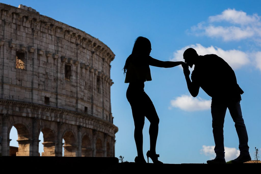 Chivalry moment at the Coliseum in silhouette image. Rome Photoshoot by the Andrea Matone photographers