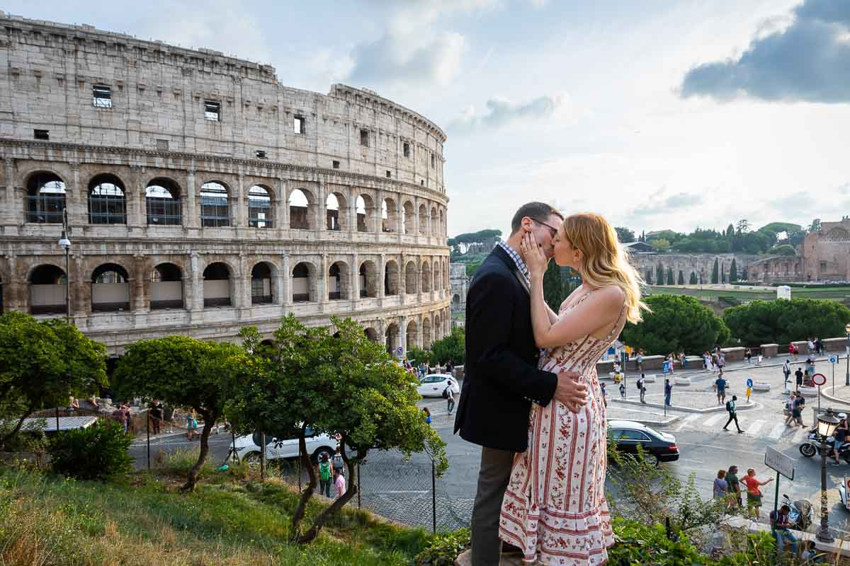 Couple kissing at the Coliseum