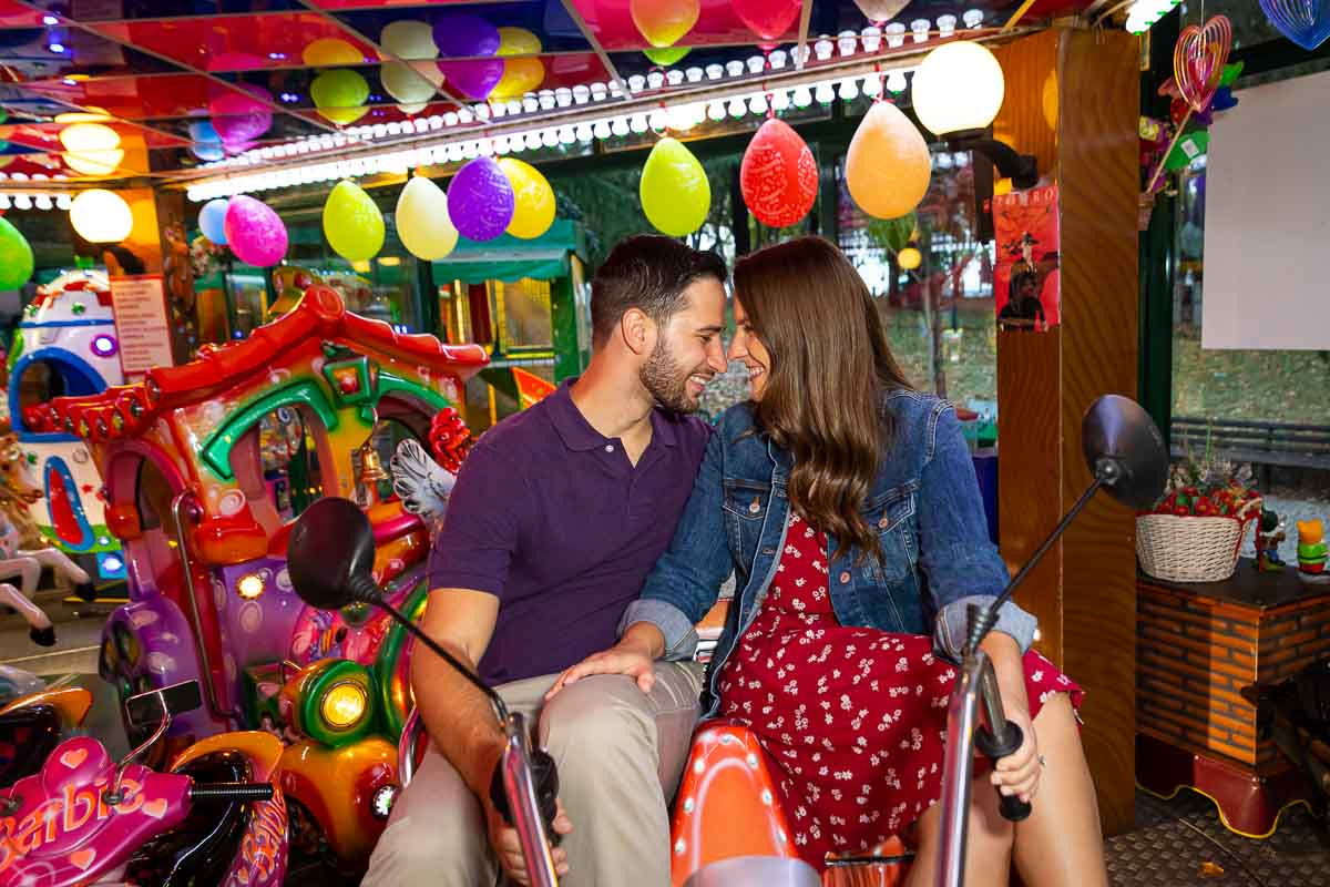Couple engaged portrait picture on an amusement ride