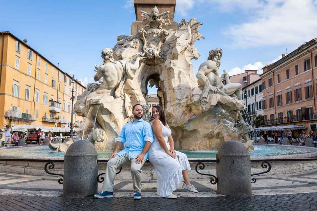 Destination Engagement Rome PhotoShoot taking pictures in the middle of Piazza Navona under the central obelisk water fountain of the 4 rivers