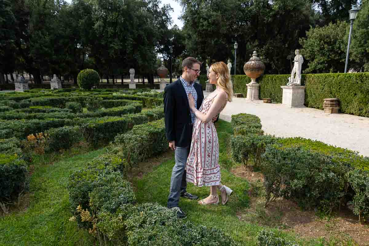 Couple posing during a photo session in the Villa Borghese gardens in Rome
