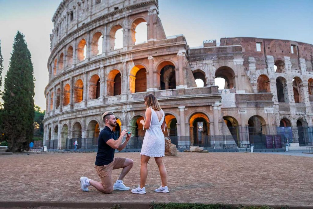Asking the BIG question Marriage wedding proposal at the Roman Colosseum in the early morning