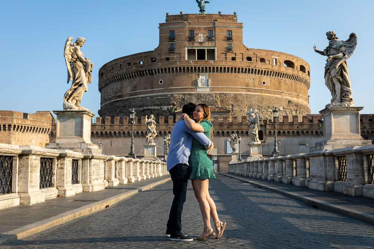 She said yes just engaged photo of a couple on the Castel Sant'Angelo bridge