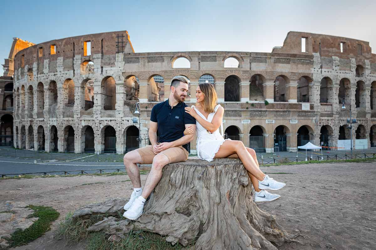 Sitting down engagement photo session in front of Rome's most iconic monument