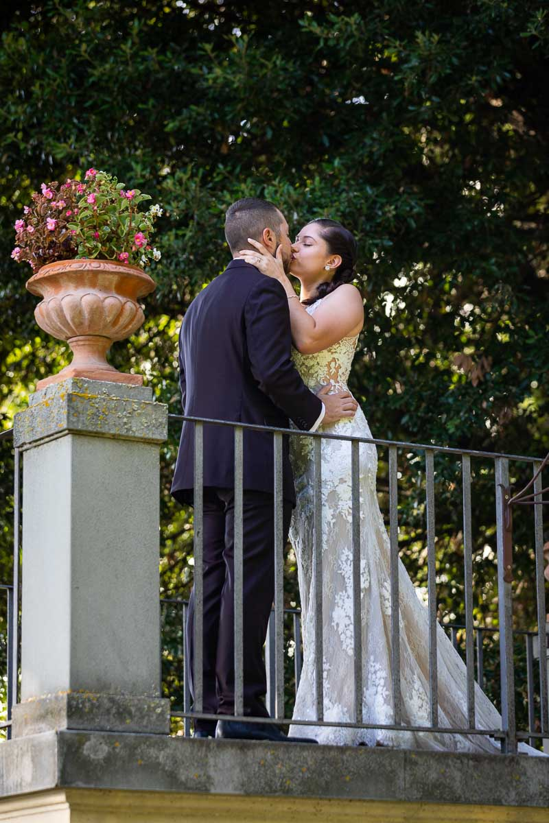 Kissing on a garden terrace overlooking the beautiful green scenery