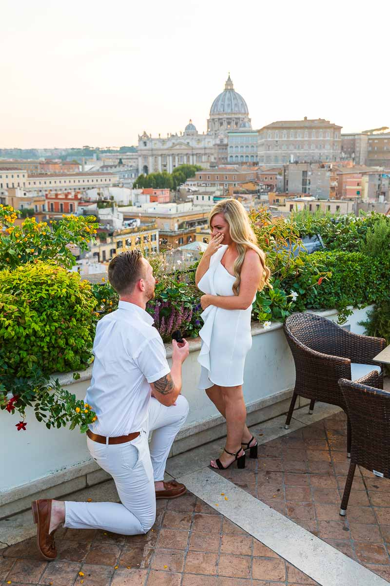 Rome surprise wedding proposal candidly photographed overlooking the city from an above roof garden terrace