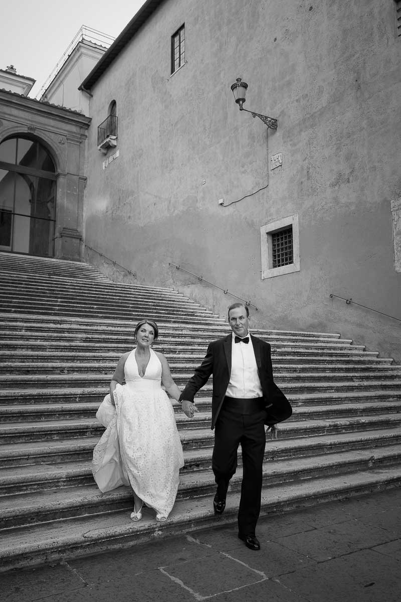 Black and white photography walking down steps in Piazza del Campidoglio