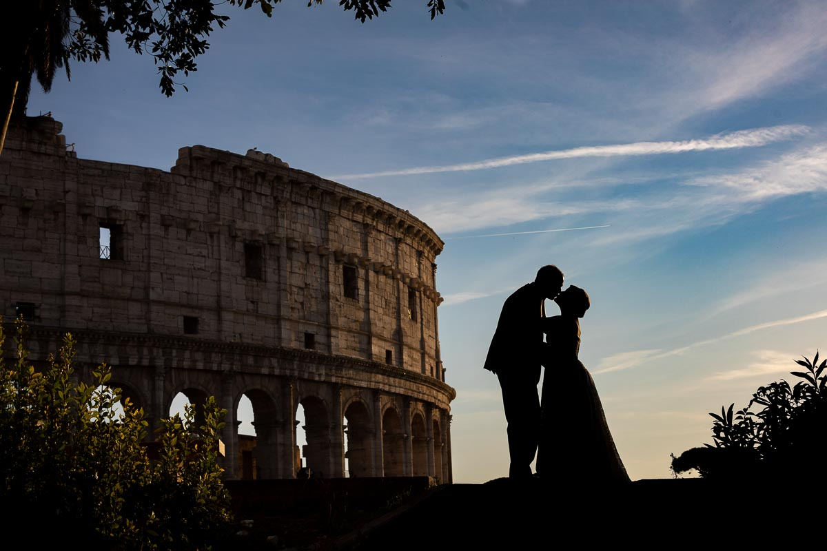 Elopement Wedding PhotoShoot in Rome Italy. Silhouette image taken at the roman coliseum