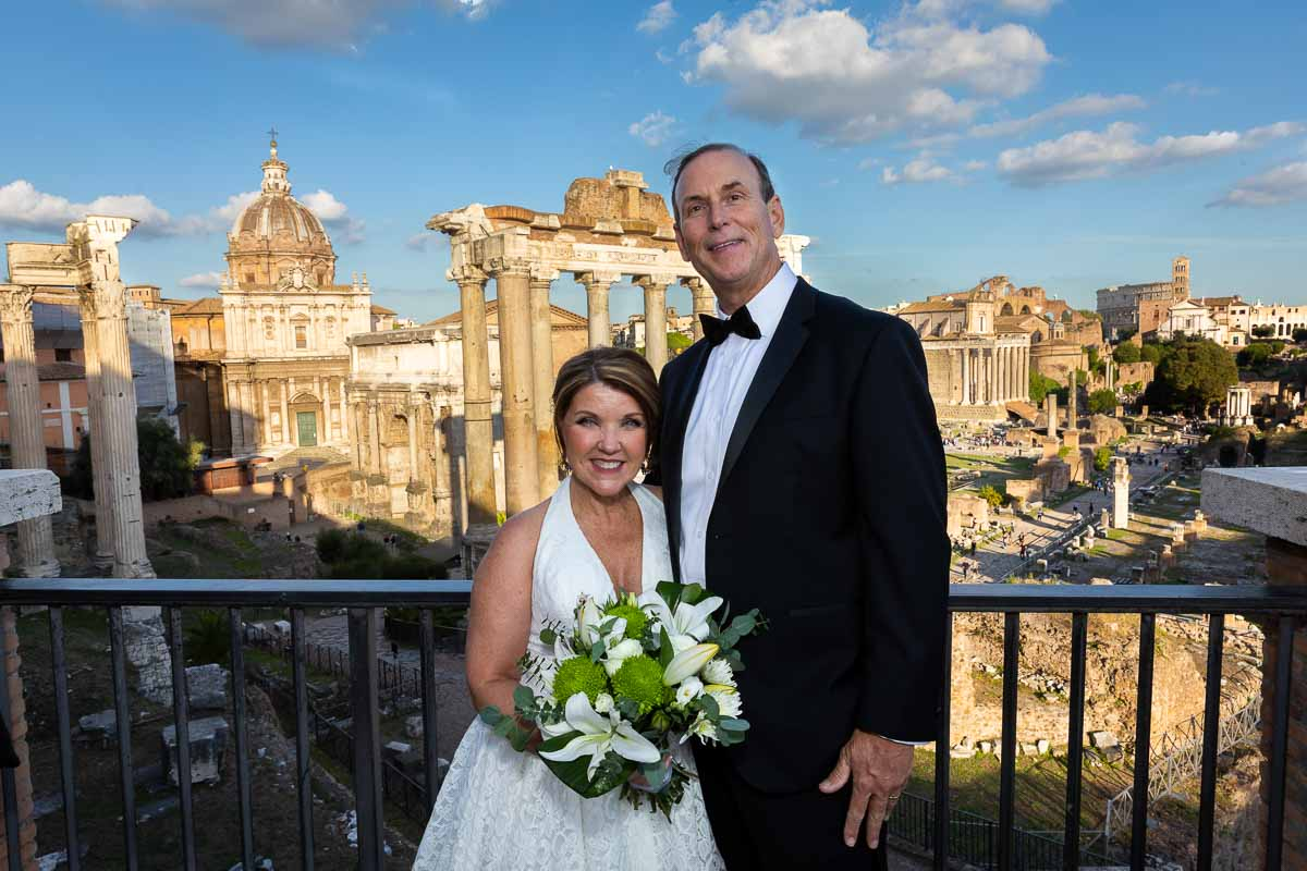 Newlyweds posed in front of the ancient roman forum