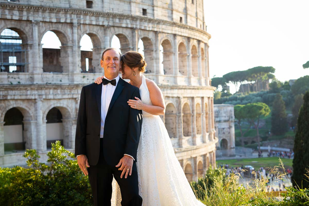 Posing picture of the bride and groom at the Coliseum in Rome Italy