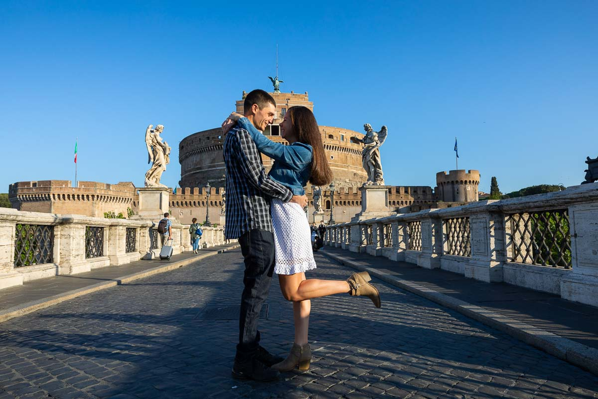 Posed portrait of a couple during an engagement photo shoot in Rome's Castel Sant'Angelo bridge