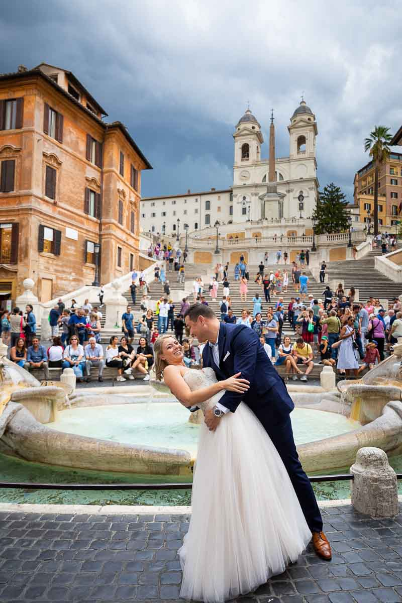 Wedding photoshoot at the Spanish steps in front of the fountain and the staircase