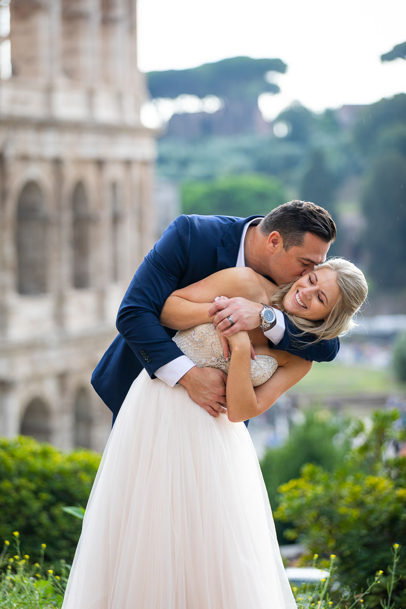 Having fun during your wedding photo session at the Colosseum in Rome Italy