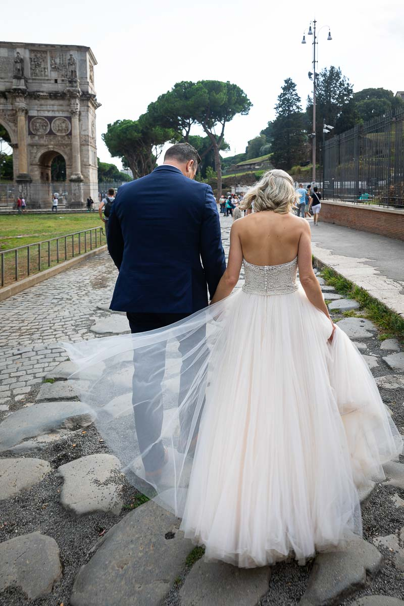 Bride & Groom walking the ancient Rome cobble stones streets